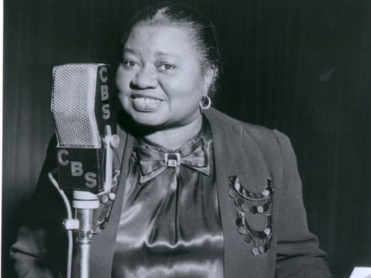 Actress Hattie McDaniel, who once performed in a Milwaukee roadhouse, takes the radio mic in this undated photo.