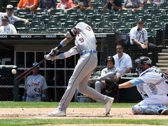 Tigers right fielder Nicholas Castellanos (9) hits a two-run homer during the first inning on Sunday, June 17, 2018, in Chicago.