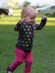 Finn Schiller, 1, of Marshfield, dances along with the music at the Marshfield Civic Band's opening concert of the summer at Columbia Park, Wednesday, June 17, 2015.