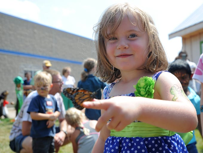 Katie Vanderloop, 4, of Mayville had a Monarch butterfly land on her hand at the Childrens Museum of Fond du Lac, Saturday, during the grand opening of a butterfly garden. 50 Monarch butterflies were released during the ceremony.