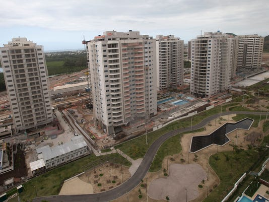 """This July 23, 2015 photo shows the apartment units that comprise Athletes Village, in Rio de Janeiro, Brazil. The 10,500 athletes at next year's Olympics will feel first-hand the deep budget cuts buffeting the Rio de Janeiro Games: they'll have to pay if they want their bedrooms air conditioned. Charging for air conditioning is part of what games organizers call finding """"fat"""" and cutting it. (AP Photo/Silvia Izquierdo)"""