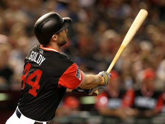 Diamondbacks' Paul Goldschmidt (44) hits a three-run