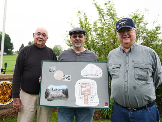 In this file photo, George Kaufman, past president of the Jonestown Lions Club and member of the American Legion Jonestown Post 883; Ed Spittle Jr., past president of the American Legion Jonestown Post 883; and Elmer Krall, past president of the Jonestown Lions Club and member of the American Legion Jonestown Post 883, pose with the plans for a Walk of Honor at the memorial site located in the Lutheran Cemetery in Jonestown on Friday, May 13, 2016. Kaufman recently announced his resignation as mayor of Jonestown.