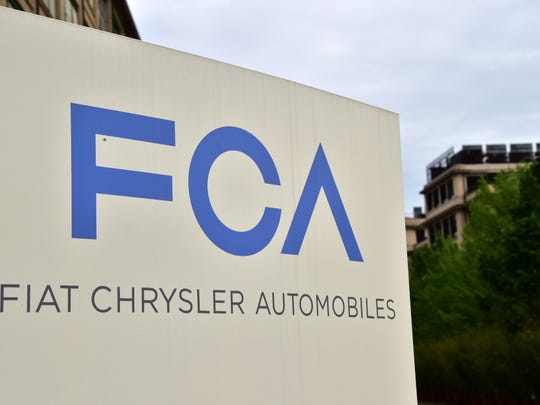 A sign a the entrance of Fiat Chrysler Automobiles NV's headquarters in Turin, Italy. The company is receiving a $7.1 billion loan backed by the Italian government as it ramps up production following the novel coronavirus outbreak.