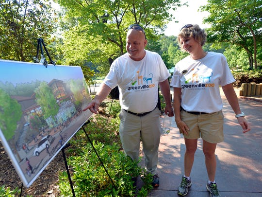 Jeff Bullock, Greenville Zoo administrator, and Beth Rusch, Zoo business administrator, look at renderings of a new front entrance to the zoo on Friday, May 8, 2015.