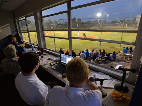 Alex Dodd, right, does play-by-play of a Travelers Rest High School baseball game May 1. Dodd and Matt DeHart, left, broadcast TR athletic events on the Devildog Sports Network.