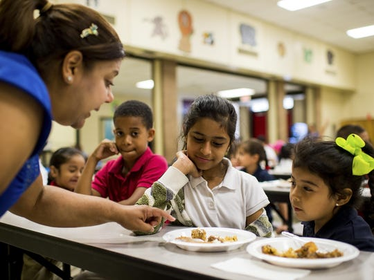 Yngrid Padilla, right, explains local food to students of the English as a Second Language, or ESL, Summer Enrichment Program at Bradmoor Elementary in 2015. Officials are considering a dual Spanish/English program because of the large number of Spanish-speaking ESL students.