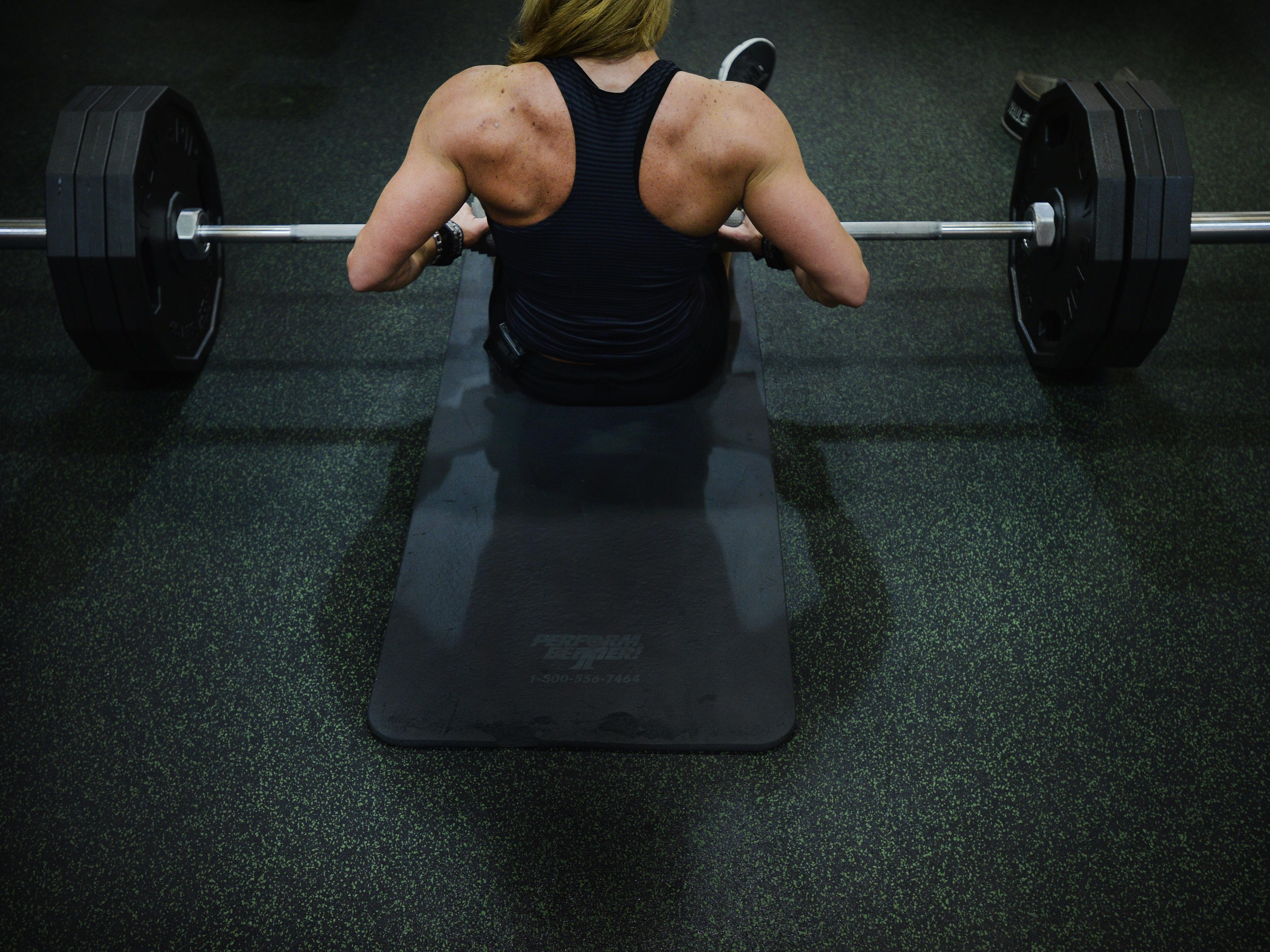 """Marie Ann """"Mo"""" Newman works out her legs at Golds Gym in Greenville."""