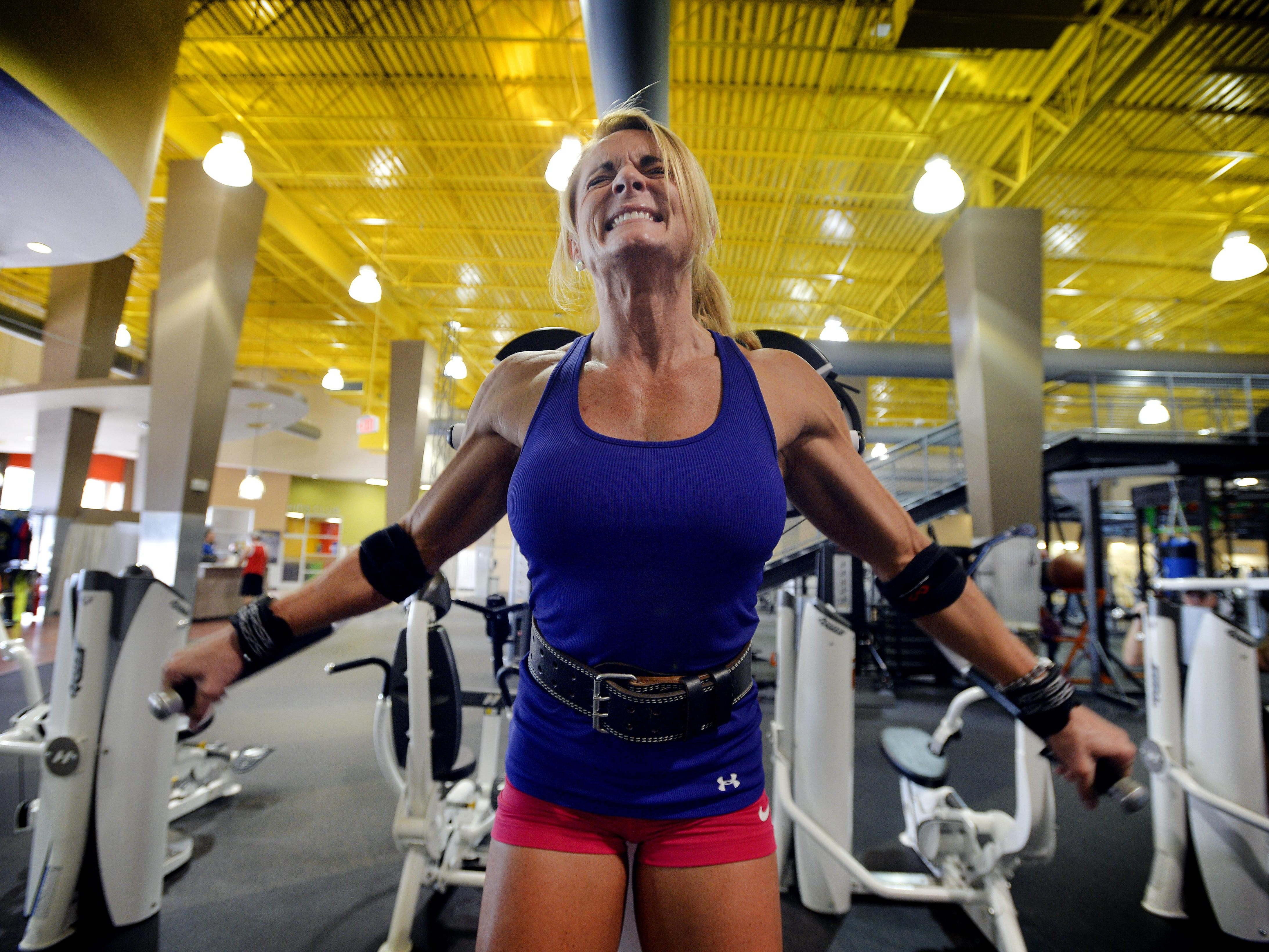 """Marie Ann """"Mo"""" Newman works on her shoulders and biceps two weeks out from her first IFBB body building competition."""