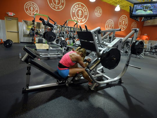 Marie Ann 'Mo' Newman works on her legs 11 days out from her first IFBB body building competition on Monday, July 27, 2015.