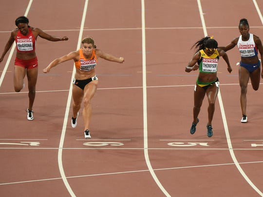 "Netherlands' Dafne Schippers (2L) crosses the finish line to win ahead of (L-R) USA's Candyce McGrone, silver medallist Jamaica's Elaine Thompson and Britain's Dina Asher-Smith in the final of the women's 200 metres athletics event at the 2015 IAAF World Championships at the ""Bird's Nest"" National Stadium in Beijing on August 28, 2015."