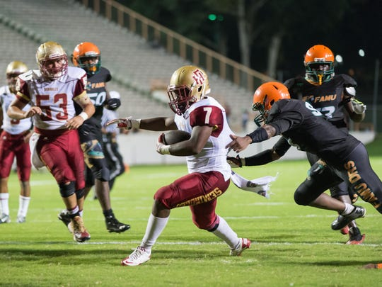 Florida High running back Trevor Lucas makes a dash to the end zone in a 42-0 win over Florida High.