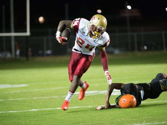 Florida High's Carlos Williams runs for a big gain in a 42-0 win over FAMU DRS.