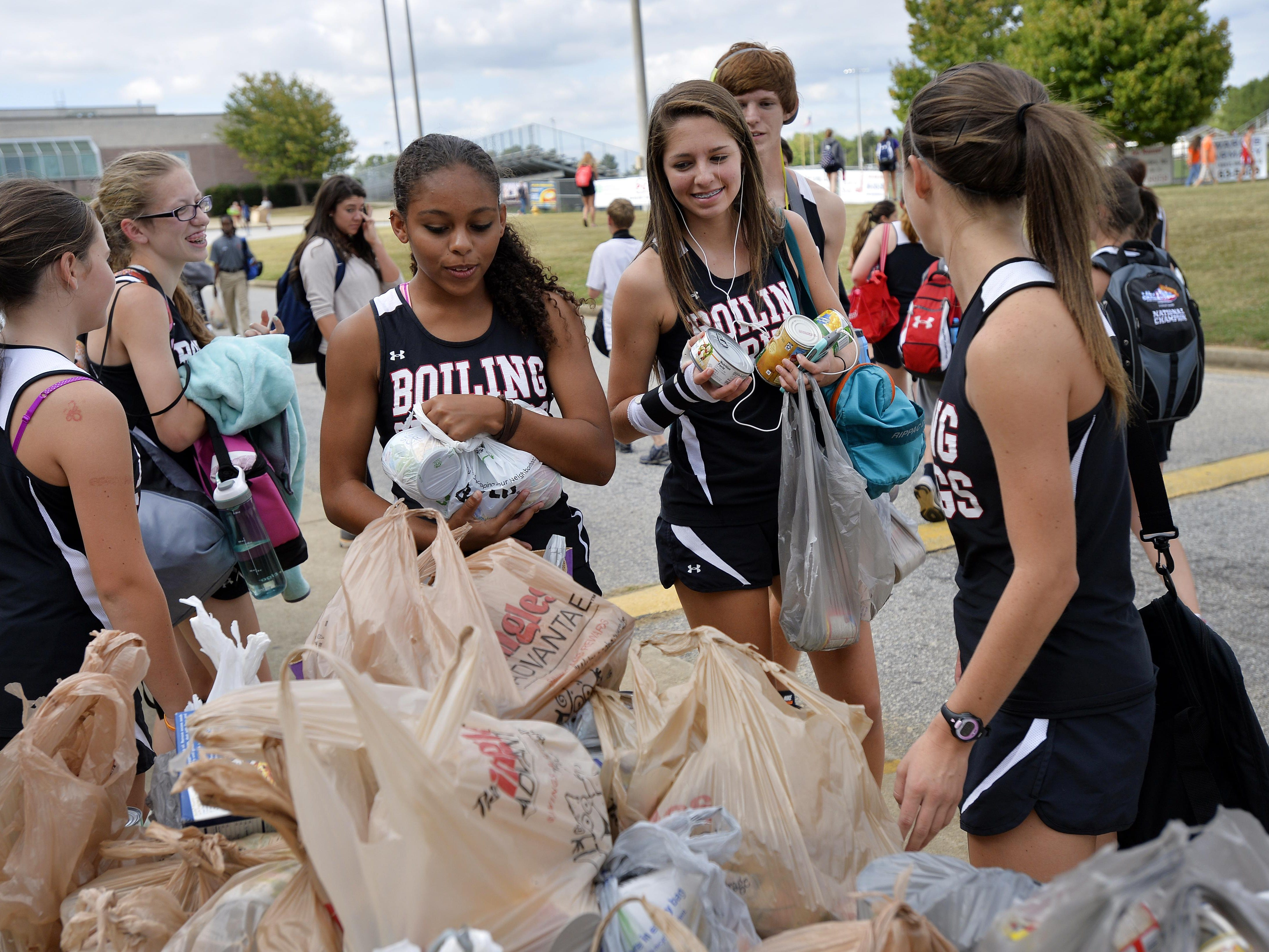Area high school runners participate in the Canned Food 5k cross country race at Hillcrest High School on Wednesday, September 23, 2015.