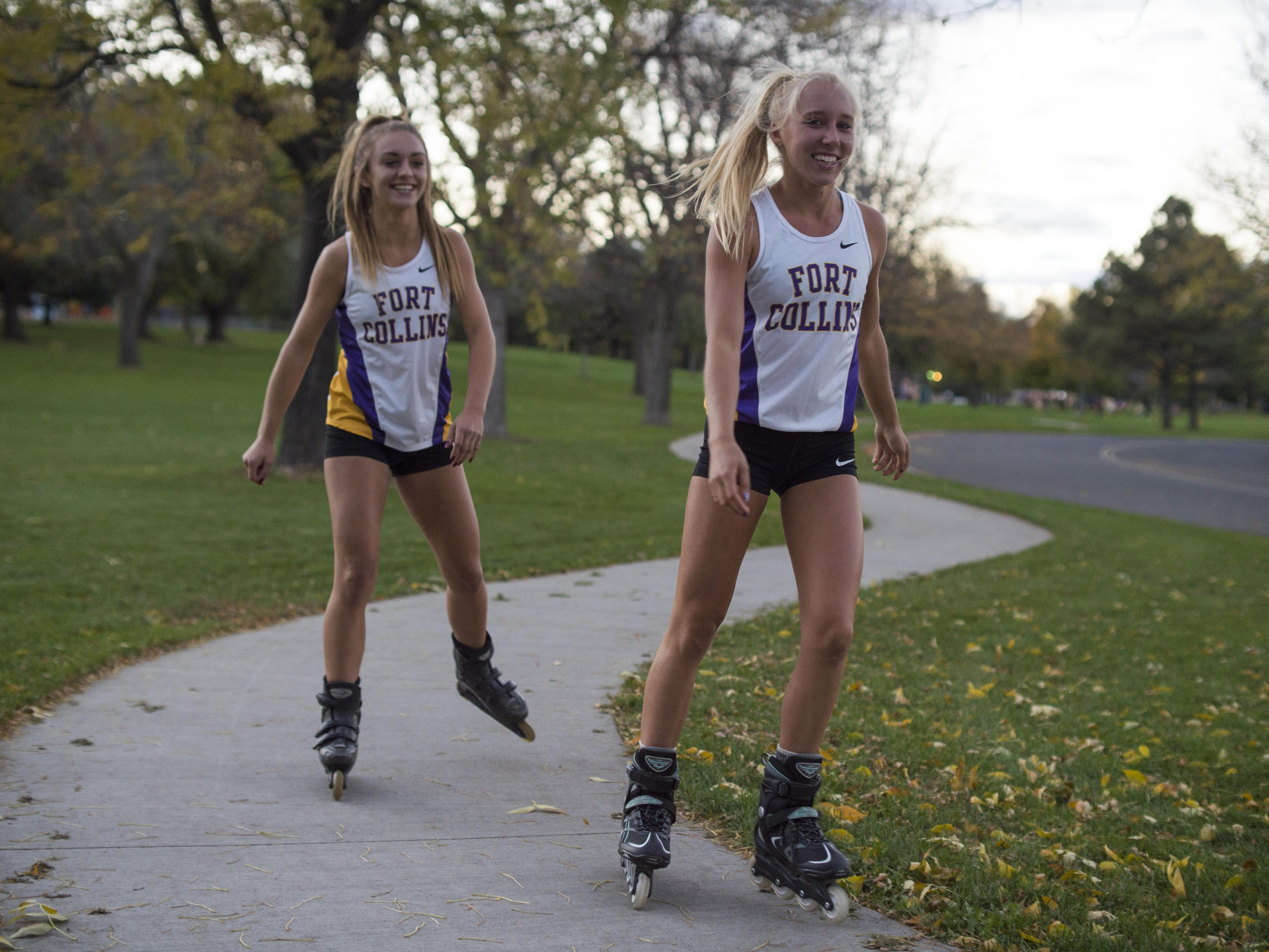 Fort Collins High School's Lauren Gregory, right, and Claire Hooker inline skate in Fort Collins' Edora Park. Gregory is a back-to-back state champion in cross country with strong prospects at Saturday's state meet in Colorado Springs.