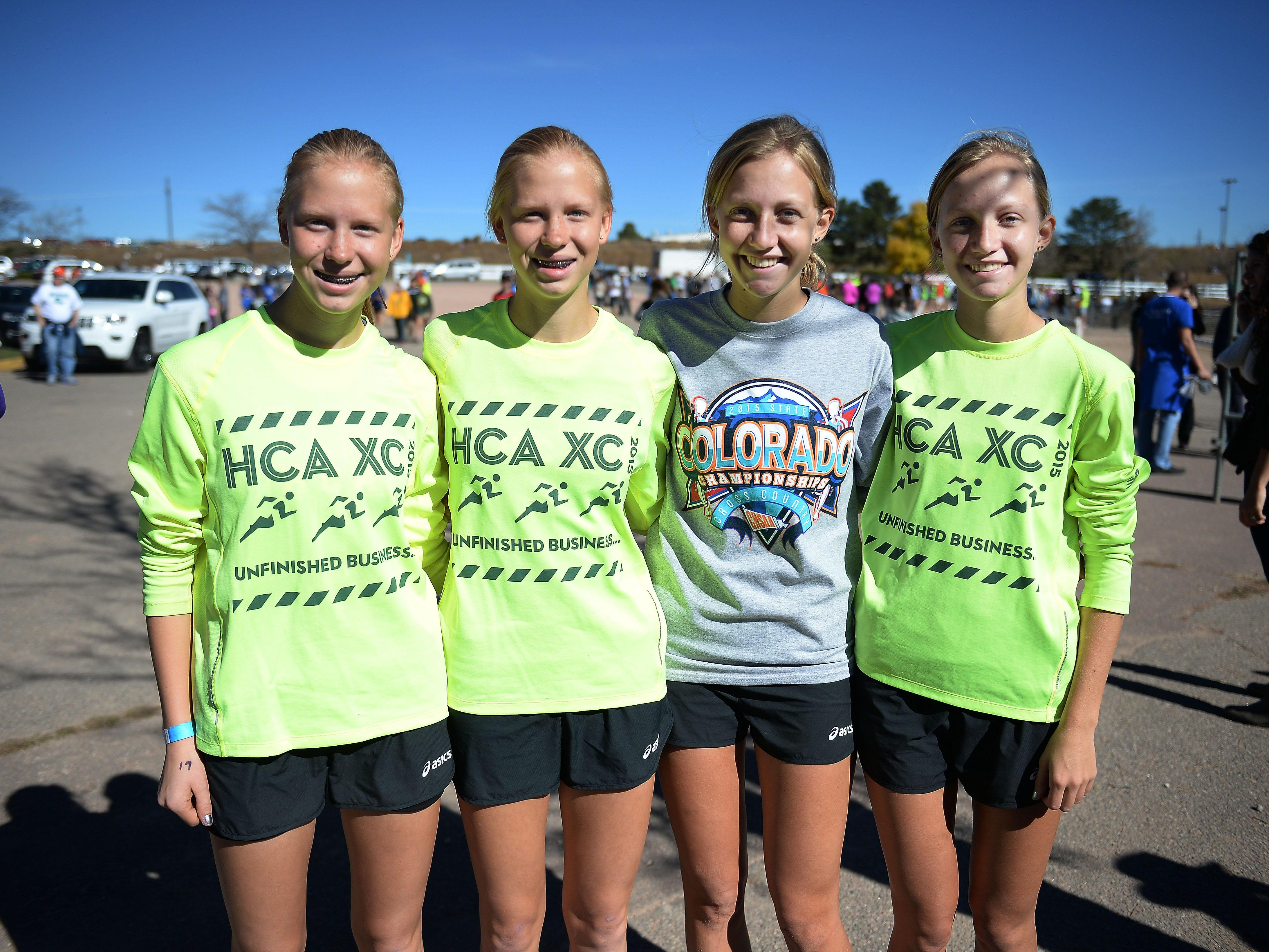 Heritage Christian runners Leeann Wagner, from left, Megan Wagner, Rebekah Rairdon and Rachel Rairdon pose for a portrait at the Colorado State Cross County Championship at Norris-Penrose Event Center in Colorado Springs on Saturday. Rachel Rairdon won the Class 2A title, with Rebekah second. The Eagles finished second as a team.