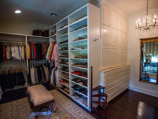 The massive walk-in closet in the home of Jim and Ginger Roy is big enough to hold just about anything, Wednesday, Nov. 18, 2015.