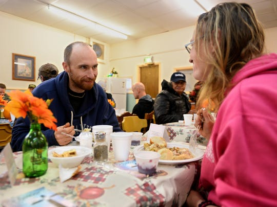 Roy and Angie Christianson enjoy Thanksgiving dinner on Thursday afternoon at the Great Falls Rescue Mission. They said they didn't have a favorite dish because everything was excellent.