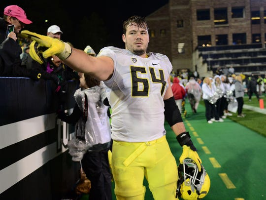 Oct 3, 2015; Boulder, CO, USA; Oregon Ducks offensive lineman Tyler Johnstone (64) celebrates the win over the Colorado Buffaloes at Folsom Field. The Ducks defeated the Buffaloes 41-24. Mandatory Credit: Ron Chenoy-USA TODAY Sports