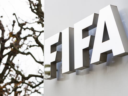 """FILE - This is a Thursday, Oct. 8, 2015 file photo of the FIFA logo  pictured at the FIFA headquarters in Zurich, Switzerland.  FIFA provisionally banned President Sepp Blatter and UEFA President Michel Platini for 90 days.  While acknowledging for the first time that votes were bought in past World Cup hosting contests, FIFA is seeking to claim """"tens of millions of dollars"""" in bribe money seized by U.S. federal prosecutors. FIFA submitted a 22-page claim to the U.S. Attorney's Office in New York on Tuesday March 15, 2016 that seeks a big share in restitution from more than $190 million already forfeited by soccer and marketing officials who pleaded guilty in the sprawling corruption case. (Dominic Steinmann/Keystone via AP)"""