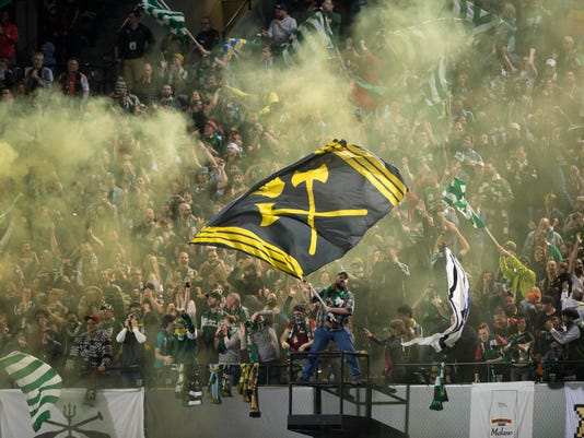 Portland Timbers fans celebrate a score against Real Salt Lake during the second half of an MLS soccer game in Portland, Ore., Saturday, March 19, 2016. The game ended in a 2-2 draw. (AP Photo/Troy Wayrynen)