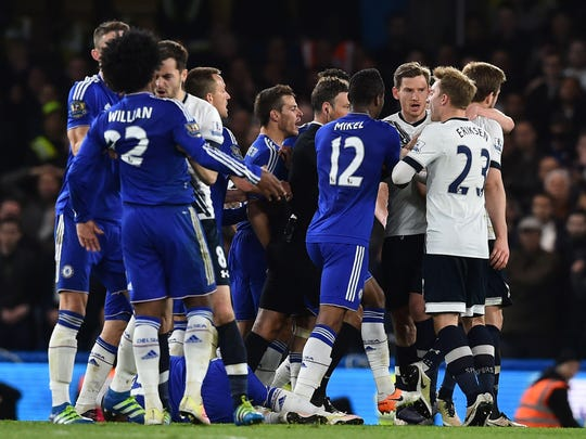 Players from both teams clash during the English Premier League football match between Chelsea and Tottenham Hotspur at Stamford Bridge in London on May 2, 2016. / AFP PHOTO / BEN STANSALL / RESTRICTED TO EDITORIAL USE. No use with unauthorized audio, video, data, fixture lists, club/league logos or 'live' services. Online in-match use limited to 75 images, no video emulation. No use in betting, games or single club/league/player publications. / BEN STANSALL/AFP/Getty Images