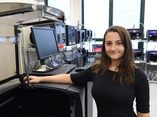 Assistant director of the Hudson Valley Advanced Manufacturing Center at SUNY New Paltz, Kat Wilson poses near a large 3D printer on April 26, 2016. Wilson has worked with prosthetists in creating artificial limbs with 3D printers at the center on several occasions. 3D printed prosthetics are often cheaper to produce than traditionally manufactured prosthetics.