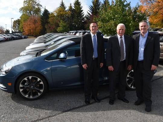 Michael Mullaney, center, president of Hudson Cadillac Buick GMC, stands with his sons Matt, left, the general manager, and Ryan, right, the service manager, at their dealership on Route 9 in the Town of Poughkeepsie.