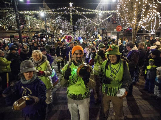 Hundreds line Church Street in downtown Burlington on New Year's Eve on Saturday night for the annual First Night Burlington parade featuring Sambatucada drummers.