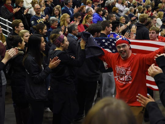 An athlete displays the American flag as he enters the opening ceremonies at the 2016 Special Olympics New York Winter Games at Mid-Hudson Civic Center in Poughkeepsie.