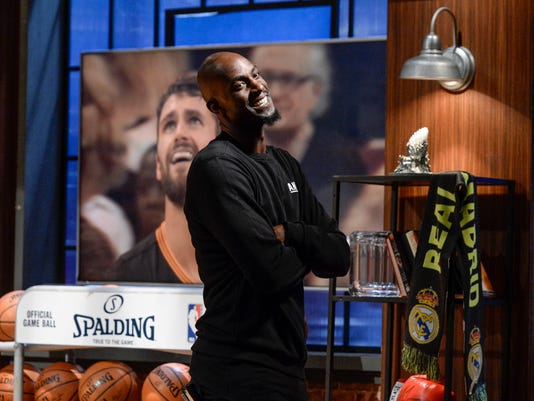 """In this photo provided by Turner Sports, Kevin Garnett gestures on the set of  """"Area 21,"""" his show-within-a-show on TNT's wildly popular basketball production. In a first for Turner Sports, the segments are geared toward social media first, and Garnett is plunging head-first into the project. (Ted Pio-Roda/Turner Sports via AP)"""