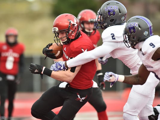 FILE - In this Dec. 3, 2016, file photo, Eastern Washington wide receiver Cooper Kupp (10) hauls in a pass against Central Arkansas during an NCAA FCS college football playoff game in Cheney, Wash. Receivers from smaller schools are hoping for additional success at the next level. Players lcan put up huge numbers in college, but since they've faced weaker competition, it's hard for NFL teams to evaluate them. (Tyler Tjomsland/The Spokesman-Review via AP, File)