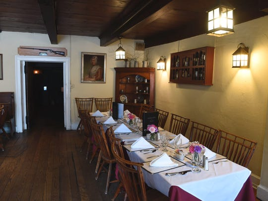 A view of one of the indoor dining rooms at the Tavern