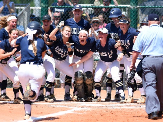 The Aucilla Christian bench clears to meet Natalie Sorensen at home plate after Sorensen hit a home run Thursday, May 18, 2017 in the state title game against Canterbury during the FHSAA Class 2A state championship at Historic Dodgertown in Vero Beach. The Warriors lost 2-1 in nine innings.