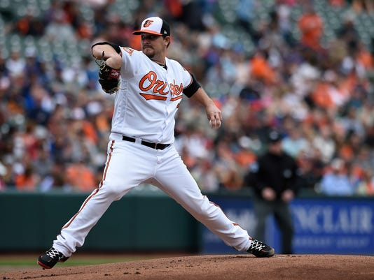 Baltimore Orioles starting pitcher Wade Miley throws against the Toronto Blue Jays in the first inning of a baseball game, Sunday, May 21, 2017, in Baltimore. (AP Photo/Gail Burton)