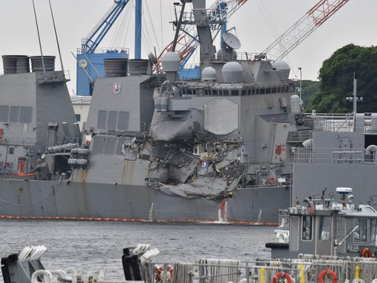 This photo shows damages on the guided missile destroyer USS Fitzgerald at its mother port in Yokosuka, southwest of Tokyo on June 18, 2017. A number of missing American sailors have been found dead in flooded areas of a destroyer that collided with a container ship off Japan's coast, the US Navy said on June 18, 2017.