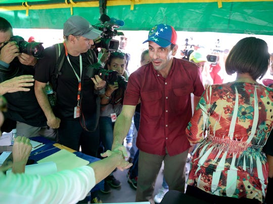 Opposition leader Henrique Capriles is pictured at a polling station in Caracas on July 16, 2017 during an opposition-organized vote against Venezuelan President Nicolas Maduro's plan to rewrite the constitution. Authorities have refused to greenlight the vote that has been presented as an act of civil disobedience and supporters of Maduro are boycotting it. Protests against Maduro since April 1 have brought thousands to the streets demanding elections, but has also left 95 people dead, according to an official toll. / AFP PHOTO / Federico PARRAFEDERICO PARRA/AFP/Getty Images