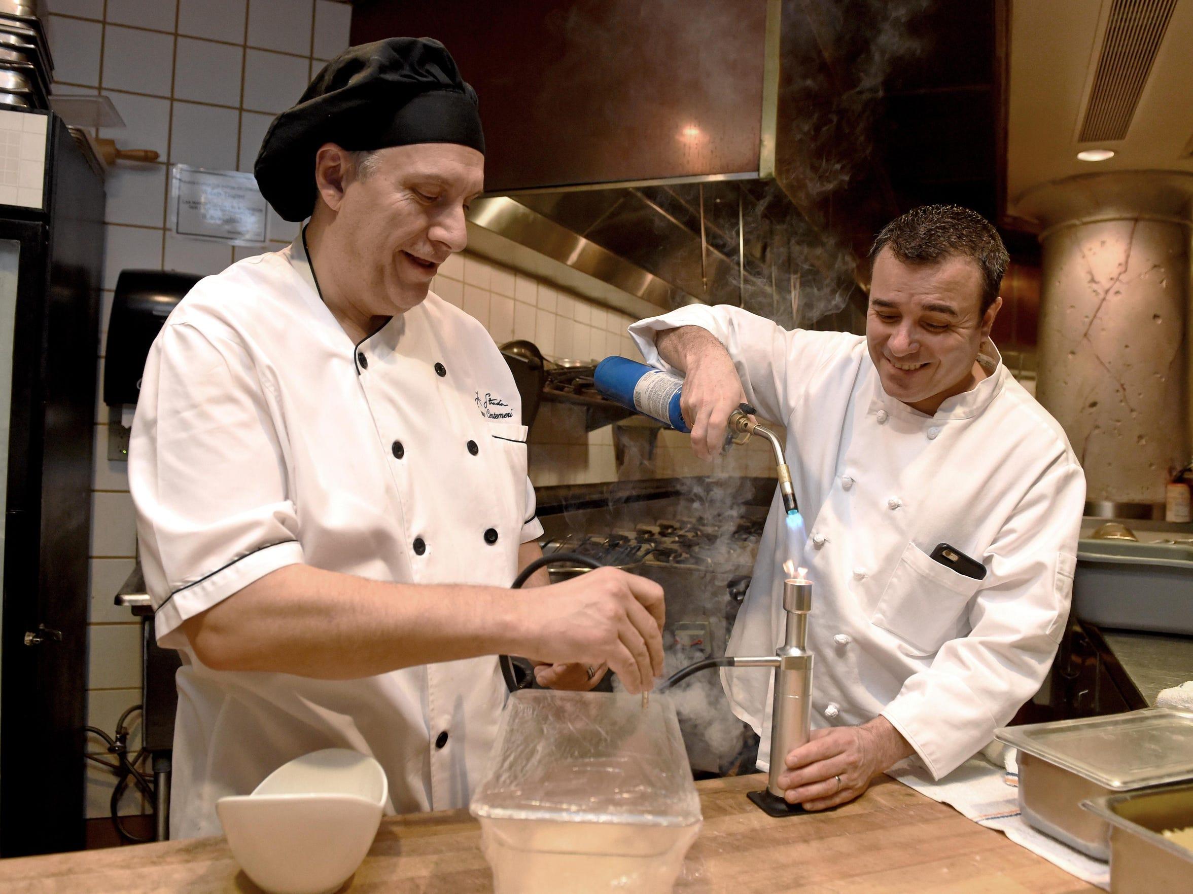 Eldorado executive chef Ivano Centemeri, left, and La Strada chef Massimo Riggio smoke lobster in the restaurant's kitchen. Don Carano, the late Eldorado founder, sometimes recruited chefs from Italy to helm his flagship restaurant.