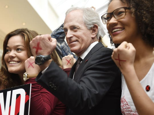U.S. Sen. Bob Corker poses with Belmont University students as he helps launch human trafficking awareness efforts on campus Feb. 22, 2016.