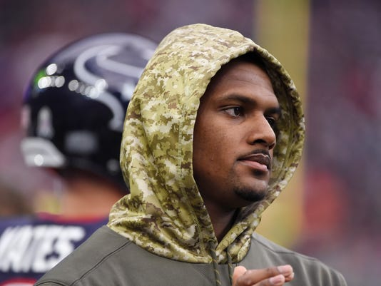 Injured Houston Texans quarterback Deshaun Watson stands on the sideline during an NFL football game against the Indianapolis Colts, Sunday, Nov. 5, 2017, in Houston. (AP Photo/Eric Christian Smith)