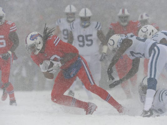 Buffalo Bills' Kelvin Benjamin, second from left, makes a catch during the first half of an NFL football game against the Indianapolis Colts, Sunday, Dec. 10, 2017, in Orchard Park, N.Y. (AP Photo/Adrian Kraus)