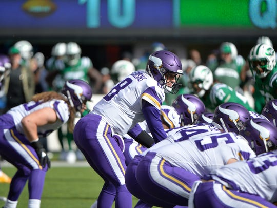 Vikings quarterback Kirk Cousins looks over his offensive line at the defense against the Jets, Oct. 21.