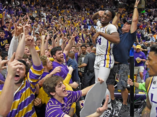 LSU forward Emmitt Williams celebrates with the LSU student section after an overtime victory against Tennessee on Feb. 23.