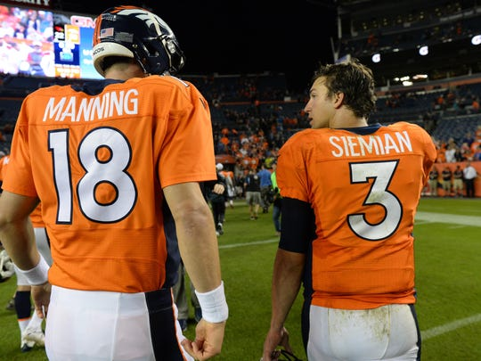 Sep 3, 2015; Denver, CO, USA; Denver Broncos quarterback Peyton Manning (18) and quarterback Trevor Siemian (3) following a preseason game against the Arizona Cardinals at Sports Authority Field at Mile High. The Cardinals defeated the Broncos 22-20. Mandatory Credit: Ron Chenoy-USA TODAY Sports