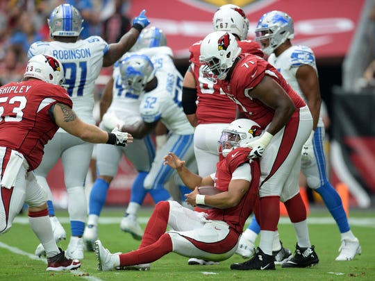 Sep 8, 2019; Glendale, AZ, USA; Arizona Cardinals quarterback Kyler Murray (1) is helped up by Arizona Cardinals offensive tackle Justin Murray (71) during the first half against the Detroit Lions at State Farm Stadium. Mandatory Credit: Joe Camporeale-USA TODAY Sports