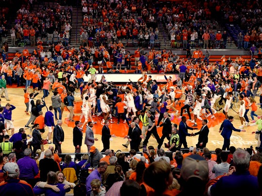 Clemson fans rush the court after the Tigers defeated Louisville 77-62 in an NCAA college basketball game Saturday, Feb. 15, 2020, in Clemson, S.C. (AP Photo/Richard Shiro)