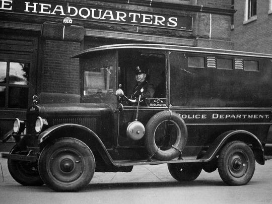 The Burlington Police Department paddy wagon, which doubled as the city's ambulance, outside its headquarters on Church Street. The building is the former fire station which is now the Firehouse Gallery.