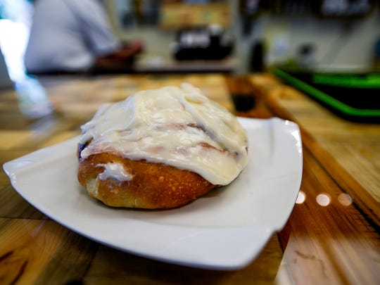 A freshly baked cinnamon roll waits to be eaten at new Fort Collins restaurant, Rise, Saturday, June 14, 2014.