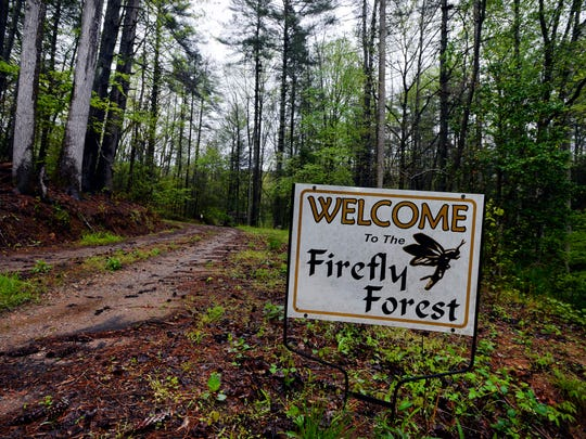 A sign welcoming visitors sits on the property of Thomas Don Lewis on Wednesday, April 15, 2015.