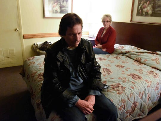 Sally Daisey visits her son Adam Richey at his room at the Relax Inn in Laurel on Wednesday.
